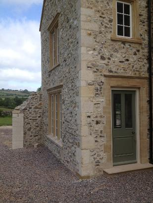 new carved Ham hill stone window surround & Bath stone chisel dressed quoins.