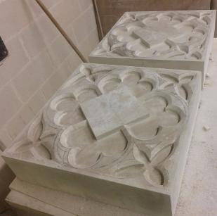 Gothic tracery panels in Portland stone.