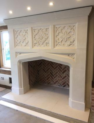 New Carved Gothic Fireplace with oak leaf tracery panels .